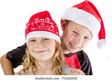 Happy siblings embrance for christmas isolated on white background