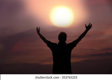 happy silhouette man embrace sky