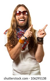 Happy and silly man dressed like a hippy pointing up at copyspace. Isolated on white.