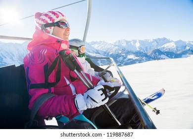 Happy skiers on a ski-lift of Zell am Ziller, Tirol, Austria