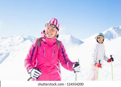 Happy skiers. Smiling woman with her daughter, Zellertal, Austria