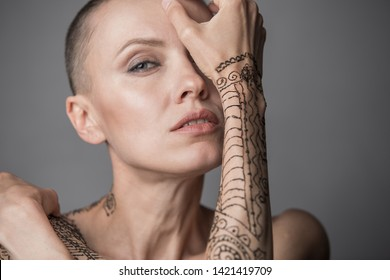 Happy Skinhead woman portrait studio short
