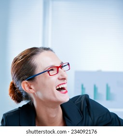 happy slim businesswoman laughing with open mouth