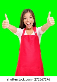 Happy small business owner excited in red apron showing thumbs up success sign isolated cutout on green chroma key background.