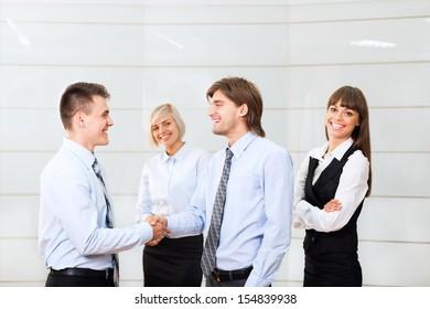 happy smile businessmen handshake standing at office, businesspeople hand shake, business people congratulating men partner, meeting at conference hall