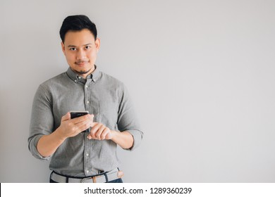 Happy smile face of handsome Asian man use smartphone.