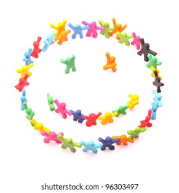 happy smiley arranged by cheerful plasticine people - isolated on white