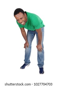 A happy smiling African American man standing in a green polo shirt