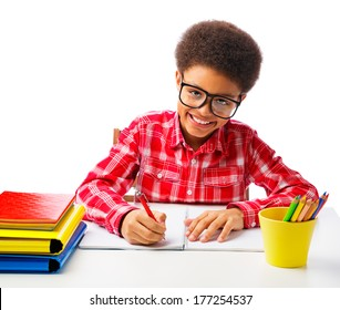 Happy smiling African American teenager, school boy studying, taking test with eyeglasses. Isolated, over white background, with copy space.
