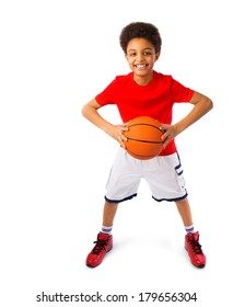 Happy smiling African American teenager with basketball, player. Full body portrait. Isolated, over white background, with copy space.