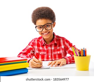 Happy smiling African American teenager, school boy studying, reading a book with eyeglasses. Isolated, over white background, with copy space.