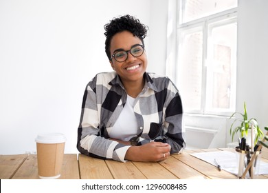 Happy smiling african teen girl looking at camera webcam making video conference call, friendly black woman communicating online or e-coaching, distance job interview, headshot portrait