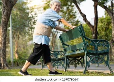 Happy smiling asian old woman exercising by stretching the leg muscles,workout,immunization,healthy female senior have strong knee and bones,health care,body balance,good healthy lifestyle of elderly