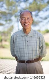Happy Smiling Asian Senior Elderly Standing Outdoor