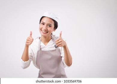 happy smiling asian woman pointing accepting ok okay yes good thumb up, domestic worker pointing thumb up, woman housekeeper, girl shopkeeper, housewife pointing thumb up, girl cleaner suggesting