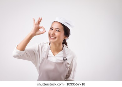 happy smiling asian woman pointing accepting yes good ok okay hand gesture, domestic worker pointing ok sign, woman housekeeper, girl shopkeeper, girl cleaner, housewife pointing ok hand symbol