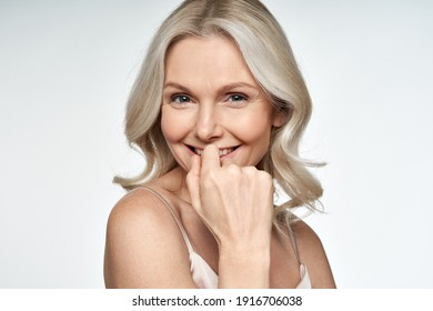 Happy smiling attractive 50s middle aged blonde woman looking at camera advertising antiage face skin and aging hair care treatment and cosmetics isolated on white background. Close up portrait. - Shutterstock ID 1916706038