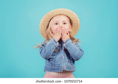 happy and smiling baby with hat on blue background