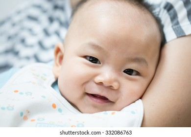 Happy smiling baby portrait with mommy