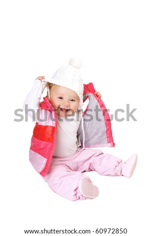 ce46bf95b9a Happy smiling baby-girl in hat and pink vest isolated on white background