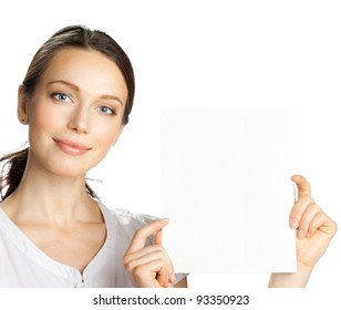 Happy smiling beautiful young business woman showing blank signboard, isolated over white background