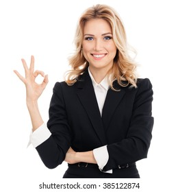 Happy smiling beautiful young businesswoman showing okay gesture, isolated against white background