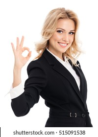 Happy smiling beautiful young businesswoman showing okay hand sign gesture, on white background. Caucasian blond model in business success concept.