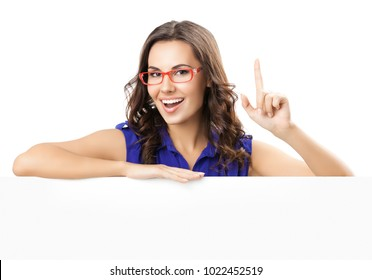 Happy smiling beautiful young woman in blue smart casual clothing and glasses, showing blank signboard or copyspace for slogan or text, isolated against white background