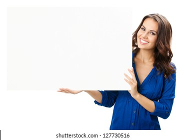 Happy smiling beautiful young woman showing blank signboard or copyspace for slogan or text, isolated over white background
