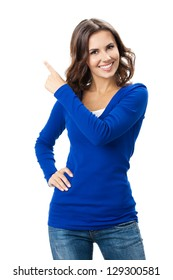 Happy smiling beautiful young woman showing copyspace, visual imaginary or something, or pressing virual button isolated over white background
