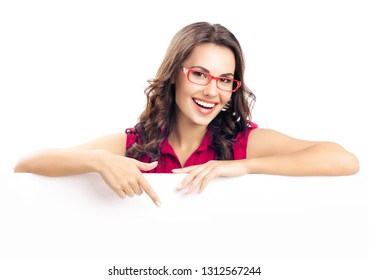 Happy smiling beautiful young woman in red smart casual clothing and glasses, showing blank signboard or copyspace for slogan or text, isolated against white background
