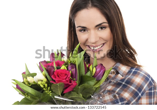 Happy smiling beautiful young woman with bouquet