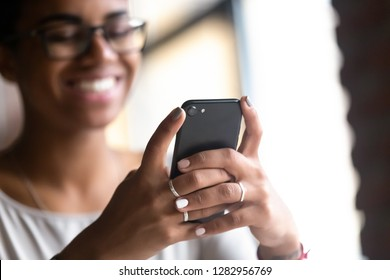 331fc1c07 Happy smiling black african woman holds mobile phone