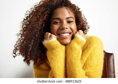 happy smiling black woman watching at camera