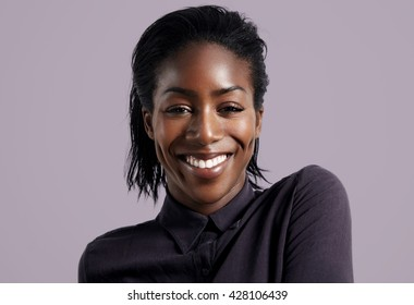 happy smiling black woman wears shirt on a violet background