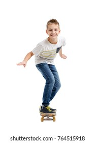 Happy smiling boy riding a skateboard isolated on white background