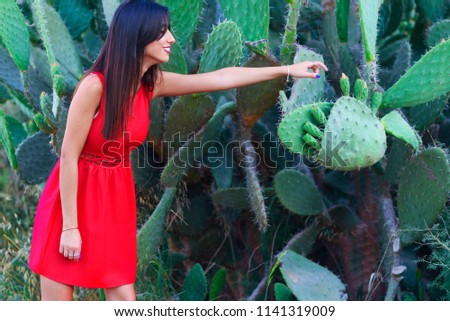 51fbfe239d Happy smiling brunette young woman standing cacti park wearing fashioned  red dress.Stylish trendy beautiful