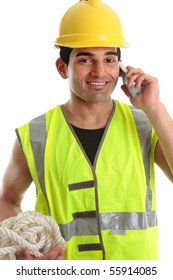 Happy smiling builder, civil engineer, construction worker, laborer using a telephone.  He is wearing yellow hard hat and reflective high visibility vest.  White background.