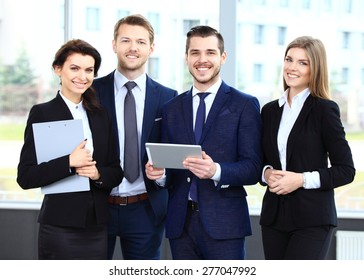 Happy smiling business team in office