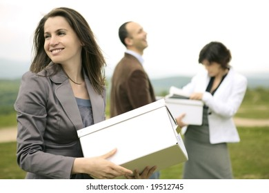 happy smiling business team outdoors organizing files and boxes on a hill