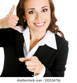 Happy smiling business woman with call me gesture, isolated against white background
