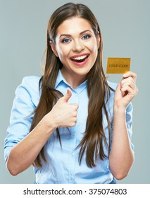 Happy smiling business woman holding credit card show thumb up. isolated studio portrait.