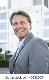A happy smiling businessman.