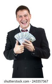 Happy smiling businessman showing thumb up and holding in his hand dollars isolated on a white background