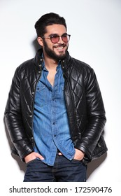happy smiling casual man in leather jacket looking away to his side