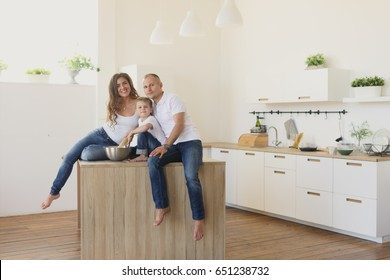 happy smiling caucasian family in the kitchen