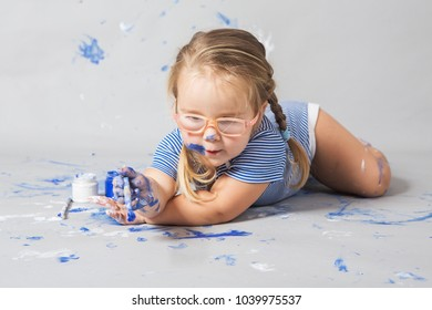 Happy smiling child full with color paint