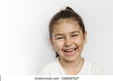 Happy smiling child girl isolated on white background. Childhood concept.