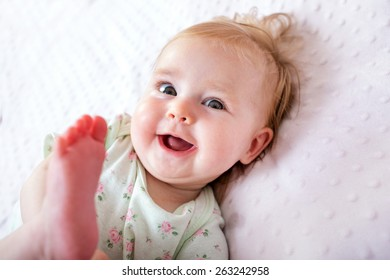 happy smiling child lying in bed