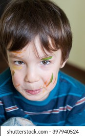 Happy smiling child with painted face.